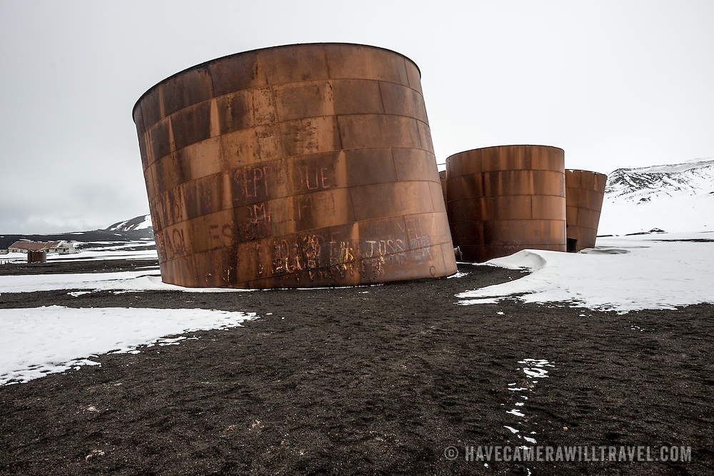Large metal oil tanks slowly rusting on the beach in an abandoned whaling station at Whalers Bay on Deception Island. Deception Island, in the South Shetland Islands, is a caldera of a volcano and is comprised of volcanic rock.