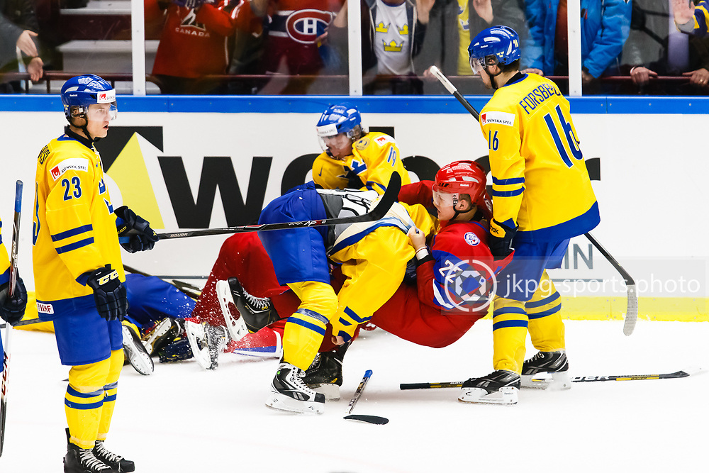 140104 Ishockey, JVM, Semifinal,  Sverige - Ryssland<br /> Icehockey, Junior World Cup, SF, Sweden - Russia.<br /> Andrei Mironov, (RUS) fights with an unidentified Swedish player. After the game.<br /> Gruffas,gruff,fight, efter matchens slut.<br /> Endast f&ouml;r redaktionellt bruk.<br /> Editorial use only.<br /> &copy; Daniel Malmberg/Jkpg sports photo