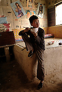 Han Yaqiang an 11 years old orphan at his grand mother's house. His mother, overwhelmed by misery, killed herself when he was 3. His father died of diabetes 4 years later. He is living at his grand-motherís.