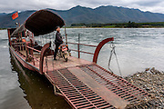 A ferry moves passengers between the Olive Dam Dai cultural village to Manhenuan village in Xishuangbanna, China.