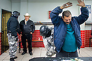 "05 FEBRUARY 2005 - NOGALES, SONORA, MEXICO: Police in Nogales, Mexico, search bar patrons during an anti-gang sweep. Members of ""Grupo Operativos"" a special operations unit of the Nogales, Sonora, Mexico, police department, on patrol in Nogales, Saturday night, Feb. 5. The Operativos specialize in anti-gang enforcement and drug interdiction missions. In recent months they have stepped up patrol activity in Nogales communities near the border. In January 2005, the US Department of State has issued a travel advisory advising US citizens to avoid travel along the US Mexican border because of increased violence, including the kidnapping of US citizens, in border communities. Most of the violence has been linked to the drug cartels, who are increasingly powerful in Mexico. The Operativos also patrol the districts of Nogales frequented by US tourists in an effort to prevent crime directed against US citizens.   PHOTO BY JACK KURTZ"