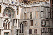 "The façade of Saint Mark's Basilica is like a patchwork quilt made of marble. In Venice, Italy, the Byzantine architecture of Saint Mark's Basilica dates from 1063 AD. Basilica Cattedrale Patriarcale di San Marco is the cathedral church of the Roman Catholic Archdiocese of Venice. Piazza San Marco (Saint Mark's Square) is the prime walking center of Venice. The Piazzetta extends Piazza San Marco to the Venetian Lagoon waterfront. Venice (Venezia) is the capital of Italy's Veneto region, named for the ancient Veneti people from the 900s BC. The romantic ""City of Canals"" stretches across 100+ small islands in the marshy Venetian Lagoon along the Adriatic Sea. The Republic of Venice wielded major sea power during the Middle Ages, Crusades, and Renaissance. Riches from Venice's silk, grain, and spice trade in the 1200s to 1600s built elaborate architecture combining Gothic, Byzantine, and Arab styles. Venice and the Venetian Lagoons are honored on UNESCO's World Heritage List."
