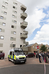 © Licensed to London News Pictures. 04/06/2017. LONDON, UK.  Residents watch as a police van leaves the flats after four women were removed by police from the block of flats in Kings Road, Barking that police raided this today in connection with terror attack.  Photo credit: Vickie Flores/LNP