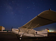 Spot landing contest on April 1, 2017 at Ak-Chin Regional Airport near Maricopa, AZ.  Some of the 99s camped overnight and were joined by Andy Estes of Desert Rat Aviation and Tim Costello, airport manager.<br /> <br /> Andy Estes' 1959 7EC Champ sleeps through the night as the Milky Way sparkles overhead.