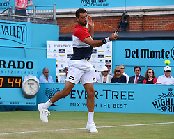 June 20, 2018 - London, England, United Kingdom - Marin Cilic (CRO) in action .during Fever-Tree Championships 2nd Round match between Frances Tiafoe (USA) against Leonardo Mayer(ARG) at The Queen's Club, London, on 20 June 2018  (Credit Image: © Kieran Galvin/NurPhoto via ZUMA Press)