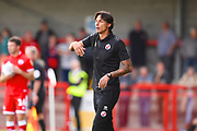 Crawley Town manager Gabriele Cioffi instructs his players from the bench in the first half during the EFL Sky Bet League 2 match between Crawley Town and Morecambe at the Broadfield Stadium, Crawley, England on 15 September 2018.