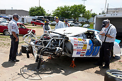 STOCKTON, CA - MAY 03:  NASCAR officials inspect the wreckage of the car belonging to John Wood driver of the #30 Holleran's Performance Toyota (not pictured) during practice before the NASCAR K&N Pro Series West Stockton 150 at the Stockton 99 Speedway on May 3, 2014 in Stockton, California. (Photo by Jason O. Watson/Getty Images for NASCAR) *** Local Caption ***