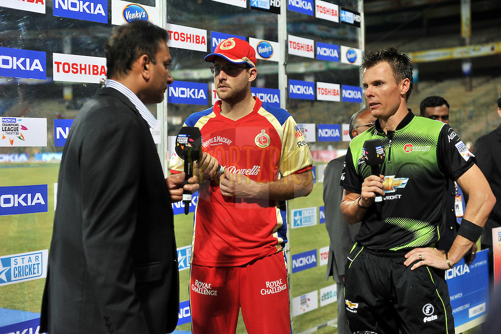 Daniel Vettori of Royal Challengers Bangalore and Johan Botha of Warriors during the presentation after the match 1 of the NOKIA Champions League T20 ( CLT20 )between the Royal Challengers Bangalore and the Warriors held at the  M.Chinnaswamy Stadium in Bangalore , Karnataka, India on the 23rd September 2011..Photo by Pal Pillai/BCCI/SPORTZPICS