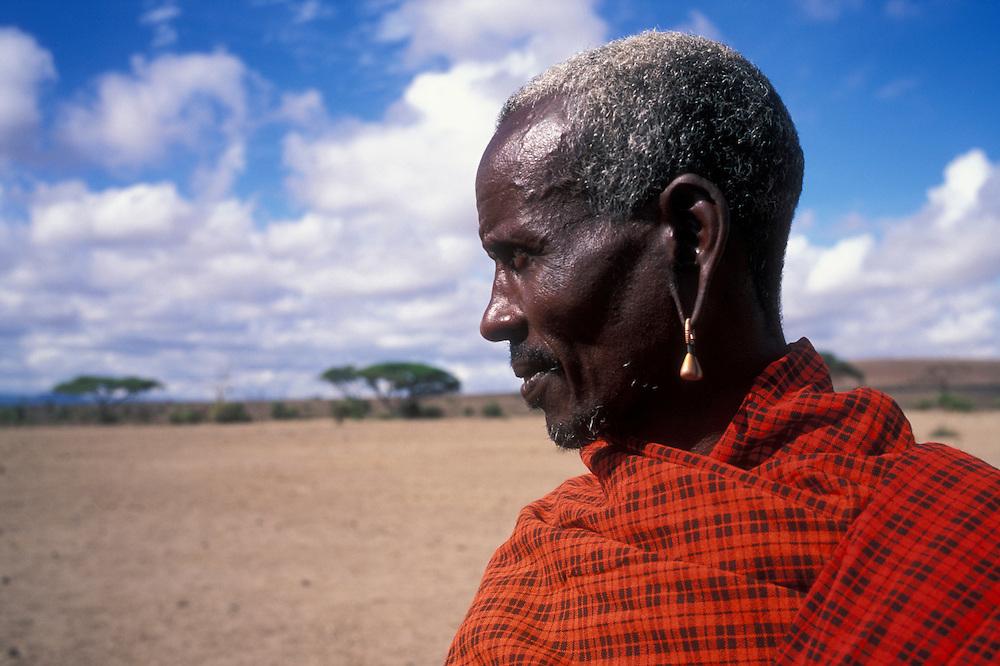 Africa, Kenya, Amboseli National Park, Portrait of elderly Masai tribesman in morning light