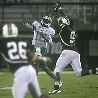 Marshall quarterback Rakeem Cato (12) eludes Central Florida defensive lineman Victor Gray (91) during an NCAA football game between the Marshall Thundering Herd and the Central Florida Knights at Bright House Networks Stadium on Saturday, October 8, 2011 in Orlando, Florida. (Photo/Alex Menendez)