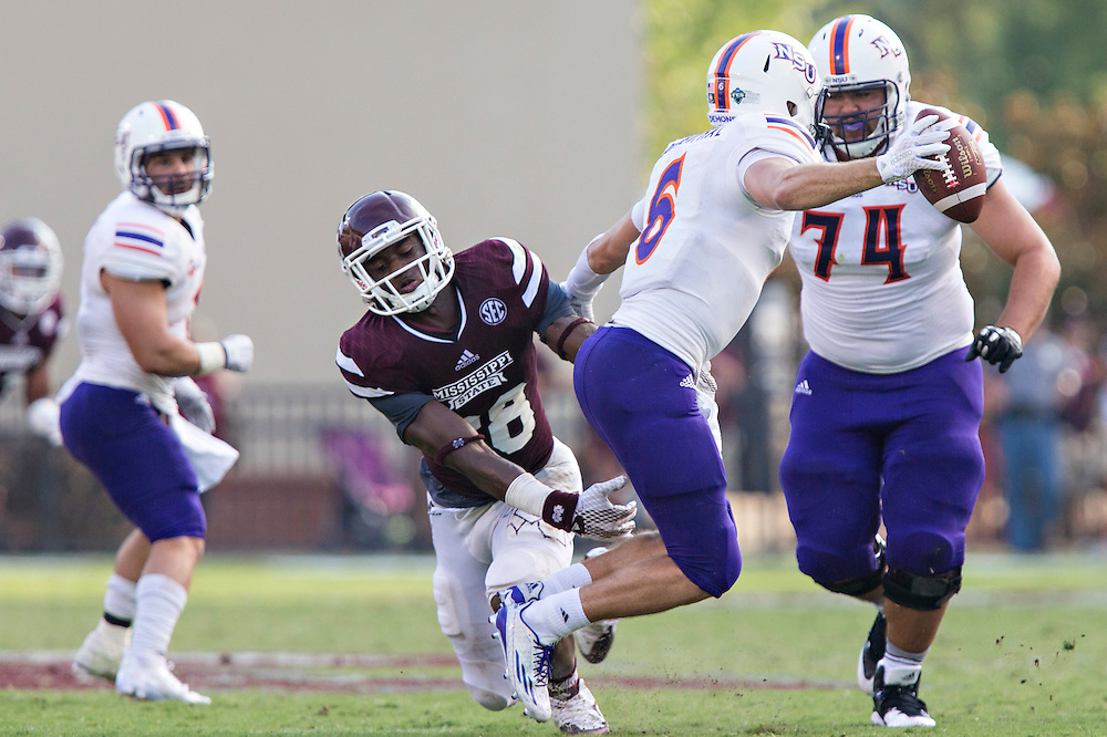 STARKVILLE, MS - SEPTEMBER 19:  DeAndre Ward #28 of the Mississippi State Bulldogs tries to tackle Joel Blumenthal #6 of the Northwestern State Demons at Davis Wade Stadium on September 19, 2015 in Starkville, Mississippi.  The Bulldogs defeated the Demons 62-13.  (Photo by Wesley Hitt/Getty Images) *** Local Caption *** DeAndre Ward; Joel Blumenthal