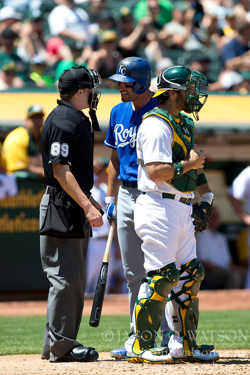 OAKLAND, CA - MAY 19: Jeff Francoeur #21 of the Kansas City Royals argues a called third strike with umpire Cory Blaser #89 during the fourth inning against the Oakland Athletics at O.co Coliseum on May 19, 2013 in Oakland, California. The Oakland Athletics defeated the Kansas City Royals 4-3. (Photo by Jason O. Watson/Getty Images) *** Local Caption *** Jeff Francoeur; Cory Blaser