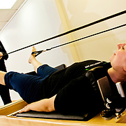 Alexis Colangelo (left) instructs Jeri Kott during a pilates session at Pure Pilates Hair and Body.