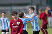 Leon Winterton is congraulated after firing Grove into a 2-0 lead - Grove (blue and white) v. Harris (red) in the U13 Logie Cup Final  (sponsored by DFCSS) at Whitton Park, Dundee, Photo: David Young<br /> <br />  - &copy; David Young - www.davidyoungphoto.co.uk - email: davidyoungphoto@gmail.com