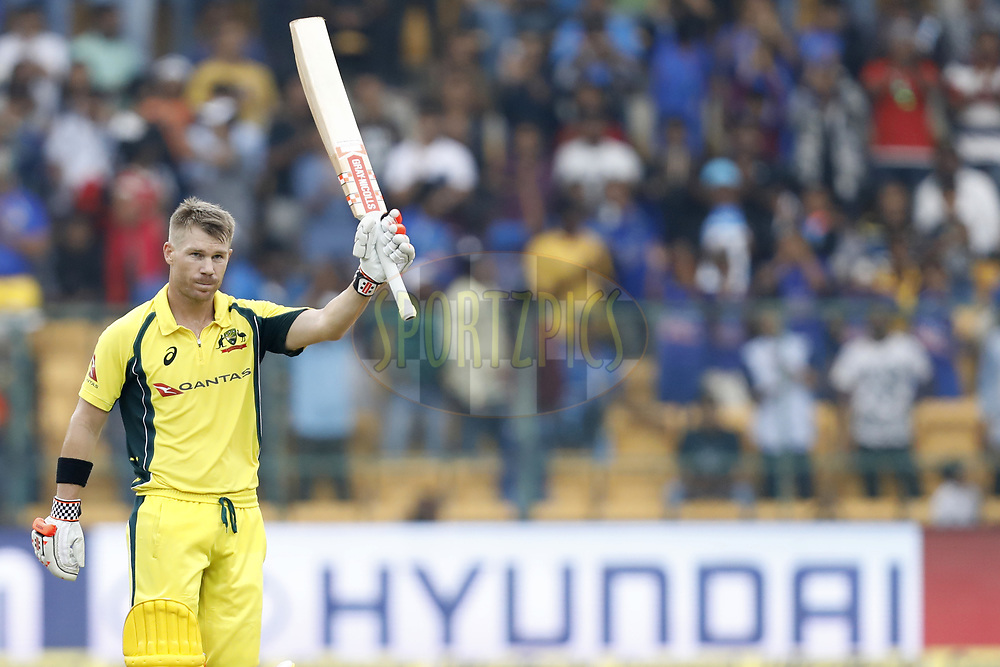 David Warner of Australia celebrates his Hundred runs with Aaron Finch of Australia during the 4th One Day International between India and Australia held at the M. Chinnaswamy Stadium in Bengaluru on the 28th  September 2017<br /> <br /> Photo by Arjun Singh / BCCI / SPORTZPICS
