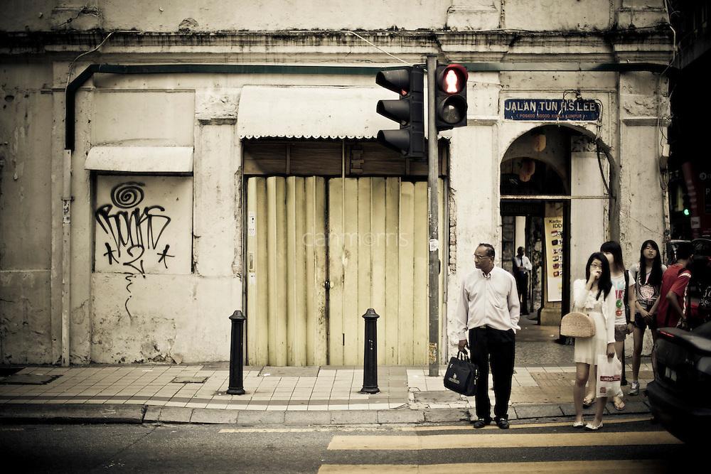 Crossing the street in downtown Kuala Lumpur