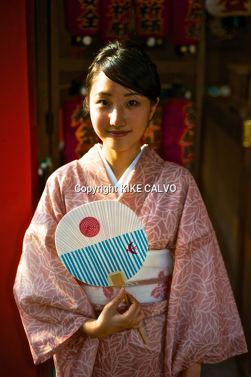 Asian woman wearing traditional kimono at the Kiyomizu Temple.
