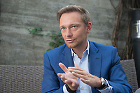 21 AUG 2015, BERLIN/GERMANY:<br /> Christian Lindner, FDP Bundesvorsitzender, waehrend einem Interview, Espresso Bar<br /> IMAGE: 20150821-01-013