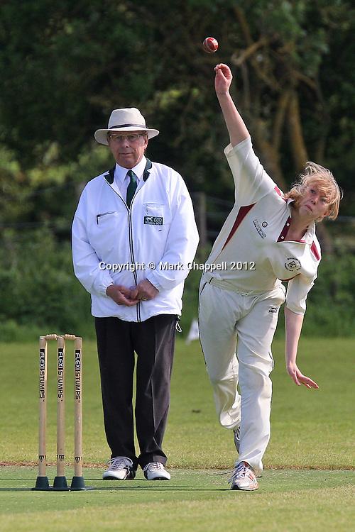 BIDDESTONE, UNITED KINGDOM. May 13 2012. Biddestone Cricket Club v Potterne U13.<br /> Photo Credit: Mark Chappell<br /> &copy; Mark Chappell 2012. All Rights Reserved. See instructions.