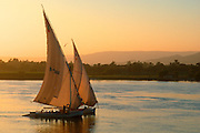 EGYPT, NILE RIVER Feluccas, traditional sailing ships on the Nile near Luxor (Thebes)