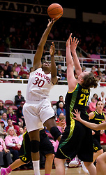 February 18, 2010; Stanford, CA, USA;  Stanford Cardinal forward Nnemkadi Ogwumike (30) shoots over Oregon Ducks guard/forward Victoria Kenyon (21) during the first half at Maples Pavilion.  Stanford defeated Oregon 104-60.