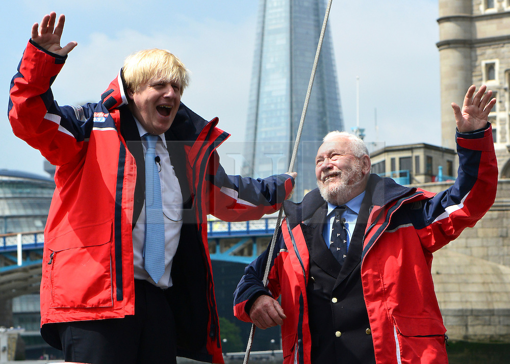 © Licensed to London News Pictures. 31/05/2013. London, UK London Mayor Boris Johnson (left) and yachtsman Sir Robin Knox-Johnston attend a photocall at the start and finish line of the 2013-14 Clipper Round the World Yacht Race. The race will leave London on 1 September 2013 and not return until July 2014. Photo credit : Stephen Simpson/LNP