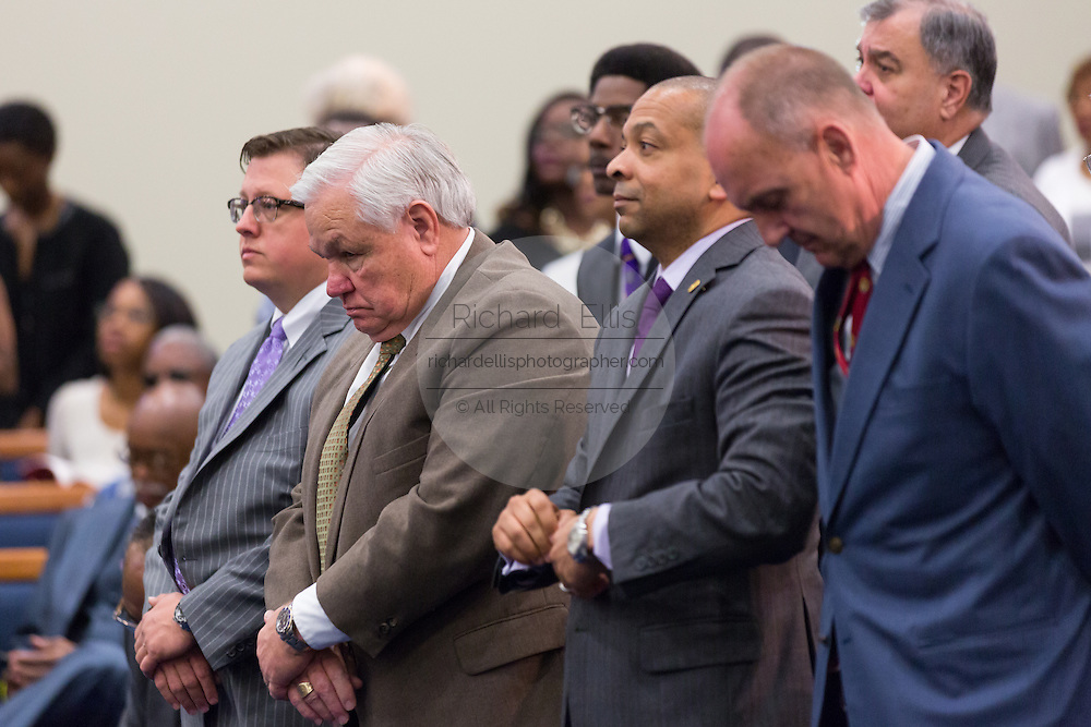 North Charleston Mayor Keith Summey bows his head in prayer as Rev. Al Sharpton addresses a healing service at Charity Missionary Baptist Church April 12, 2015 in North Charleston, South Carolina. Sharpton spoke following the recent fatal shooting of unarmed motorist Walter Scott police and thanked the Mayor and Police Chief for doing the right thing in charging the officer with murder.