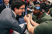 Nate Bing, 41,, right, from a group called Gen Opp, arm wrestles Max Velthoven,  21<br /> a student from Netherlands who is interning at Americans for Tax Reform, during day two of the Conservative Political Action Conference (CPAC) at the Gaylord National Resort & Convention Center in National Harbor, Md.