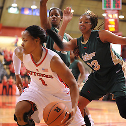 Jan 31, 2009; Piscataway, NJ, USA; Rutgers guard Khadijah Rushdan (1) protects the ball from South Florida center Jessica Lawson (23) and center Brittany Denson (32) during the second half of South Florida's 59-56 victory over Rutgers in NCAA women's college basketball at the Louis Brown Athletic Center