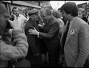 15/05/1982<br /> 05/15/1982<br /> 15 May 1982<br /> An Taoiseach, Mr Charles Haughey, canvasing with Fianna Fail bye-election candidate Eileen Lemass in Dublin West. Image shows An Taoiseach (centre) canvasing on Ballyfermot Road.