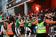 Picture by David Horn/Focus Images Ltd +44 7545 970036.27/04/2013.Doncaster Rovers clebrate their team's winning goal with fans during the npower League 1 match at Griffin Park, London.