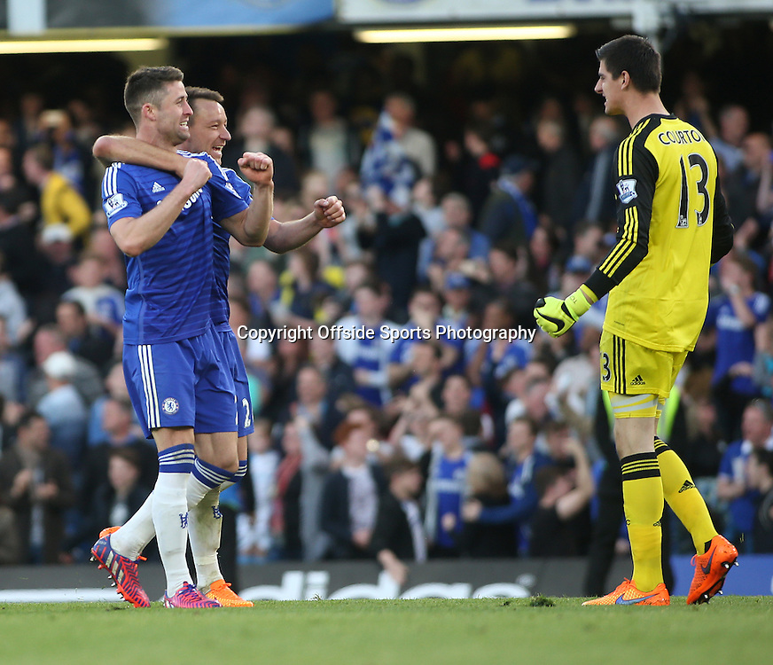 18 April 2015 - Barclays Premier League - Chelsea v Manchester United - John Terry and Gary Cahill of Chelsea celebrate at the final whistle with teammate Thibaut Courtois.<br /> <br /> <br /> Photo: Ryan Smyth/Offside