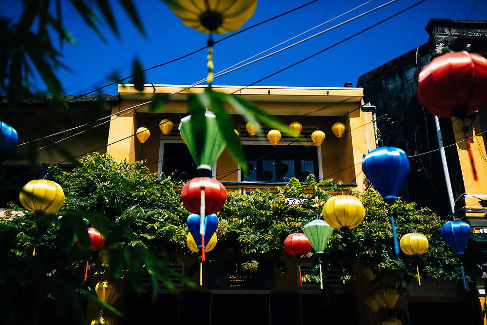 The colorful, lantern-strewn exterior of Home Restaurant in Hoi An, Vietnam.