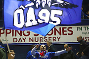 An Oldham Athletic fan celebrates with a flag following his sides victory in the EFL Cup match between Oldham Athletic and Wigan Athletic at Boundary Park, Oldham, England on 9 August 2016. Photo by Simon Brady.