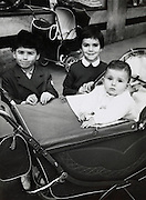children posing with baby in stroller