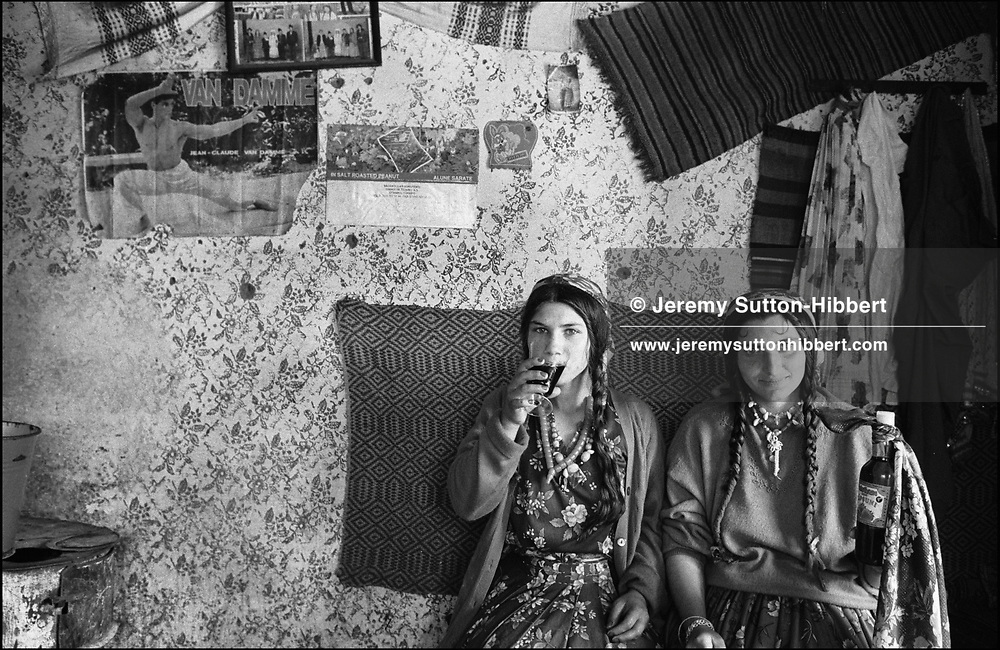 POSING FOR A PHOTO WITH ALCOHOL DURING ROMANIAN ORTHODOX EASTER CELEBRATIONS. SINTESTI, ROMANIA, EASTER 1995..©JEREMY SUTTON-HIBBERT 2000..TEL./FAX. +44-141-649-2912..TEL. +44-7831-138817.