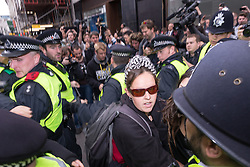 J11 protest.<br /> Police clash with protestors on Piccadilly during the J11 protest in central London by the StopG8 anti-capitalist movement,<br /> London, United Kingdom<br /> Tuesday, 11th June 2013<br /> Picture by Mark  Chappell / i-Images