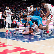 January 9, 2018, New York, NY : The St. John's and Georgetown men's basketball teams fight over a loose ball during Tuesday night's matchup between the Hoyas and Red Storm at the Garden. In something of a rematch of their 1985 contest, Basketball greats Patrick Ewing and Chris Mullin returned to Madison Square Garden on Tuesday night to face off as coaches with their respective Georgetown and St. John's teams.  CREDIT: Karsten Moran for The New York Times