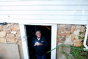 "Grady Carter went into a basement after an investigation to turn off a hose, but lingered out of curiosity to listen for ghostly sounds. The ""paranormal investigators"" of Twisted Dixie are Grady Carter, Andy Carter, Chris Carter (all related), and Chris Phillips, seen in South Carolina November 4, 2011."
