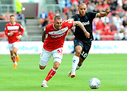 Jack Hunt of Bristol City compeets with Martin Braithwaite of Middlesbrough - Mandatory by-line: Nizaam Jones/JMP- 18/08/2018 - FOOTBALL - Ashton Gate Stadium - Bristol, England - Bristol City v Middlesbrough - Sky Bet Championship