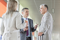 Businesspeople communicating on railroad platform