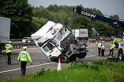© Licensed to London News Pictures. 26/08/2017. Milton Keynes, UK. A lorry being recovered from the scene on the M1 motorway near Milton Keynes after a crash involving a minibus and two lorries. Police say that several people are dead and four others have been taken to hospital after the accident on the southbound carriageway in the early hours of this morning. Photo credit: Ben Cawthra/LNP