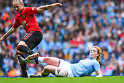 Manchester City Women defender Aoife Mannion (2) tackles Manchester United Women forward Leah Galton (11) during the FA Women's Super League match between Manchester City Women and Manchester United Women at the Sport City Academy Stadium, Manchester, United Kingdom on 7 September 2019.
