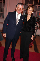 MR & MRS GEORGE MAGAN at a 'A Night in Cartier Paradise' to celebrate a new collection of jewellery by Cartier, held at The orangery, Kensington Palace, London W8 on 25th October 2005.<br />