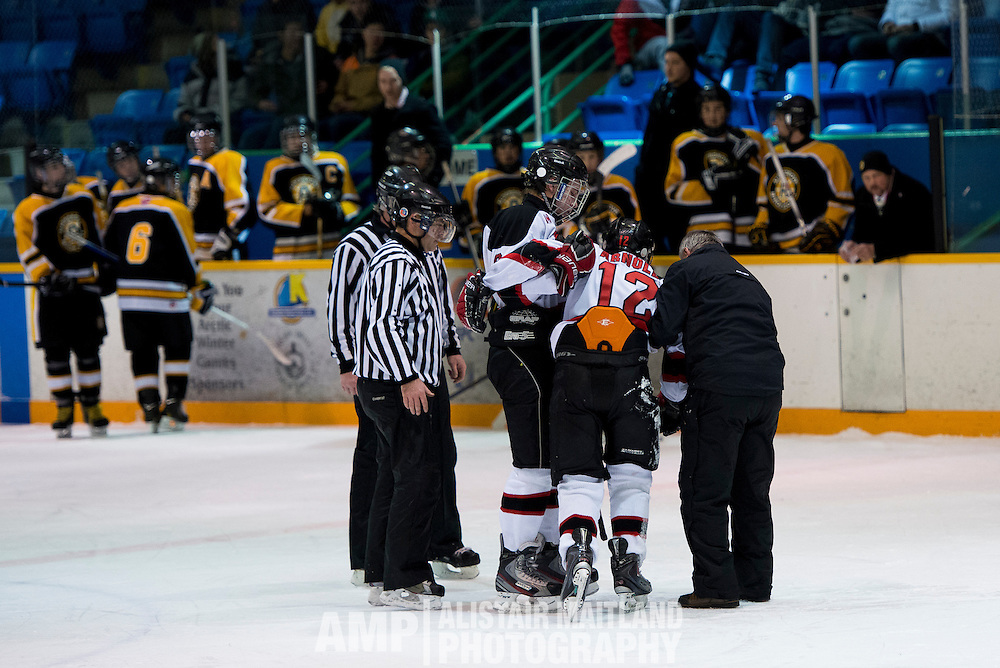 Whitehorse Mustang Graeme Close helps his team captain, Mike Arnold off the nice after a brutal hit to his knee.