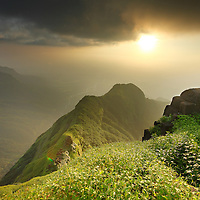 Late evening sunset Colours of monsoon, a breathtaking View from Mount Ratangad, Sahyadri, India.