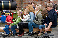 Europe, Germany, North Rhine-Westphalia, Ruhr area, Bochum, the largest festival in Germany for historical steam engines, steam rollers, steam-driven vehicles and maschines at the LWL industry museum Hannover colliery, women with children been drawn by a model of a steam truck.....Europa, Deutschland, Nordrhein-Westfalen, Ruhrgebiet, Bochum, groesstes Dampffestival in Deutschland fuer historische Dampfmaschinen, Dampfwalzen, dampfgetriebene Fahrzeuge und Maschinen auf dem Gelaende des LWL-Industriemuseum Zeche Hannover, Frauen mit Kindern lassen sich von einem Nachbau eines Dampftraktors ziehen.....[For each usage of my images the General Terms and Conditions are mandatory.]
