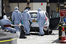 © Licensed to London News Pictures. 14/08/2018. London, UK. Police forensics officers are seen outside Parliament after a car crashed into security barriers in Parliament Square. Photo credit: Peter Macdiarmid/LNP