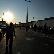 Rebel fighters rush down the road towards Muammar Gaddafi's Bab Al Azizia compound in central Tripoli.