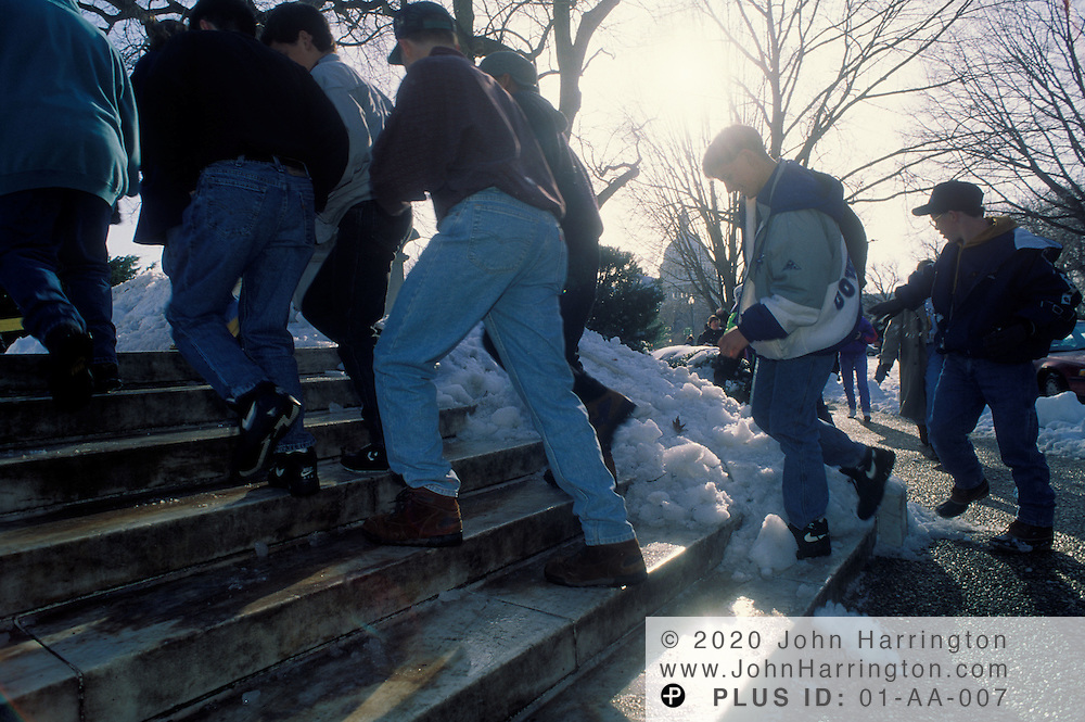 Navigating the slippery steps of the supreme court next to the US Capitol,.Youth enjoy a day of no school in Washington DC.